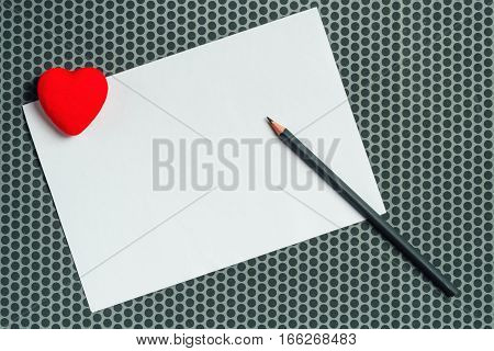 Love letter mock up blank valentine's day card with red heart and pencil copy space