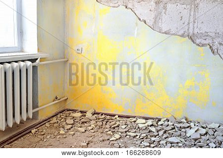 Destroyed Dirty Empty Yellow Interior With Vintage Radiator