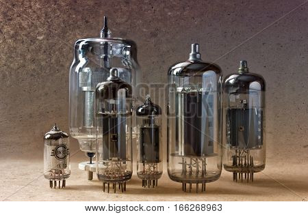 electronic background with vintage vacuum tubes on kraft paper