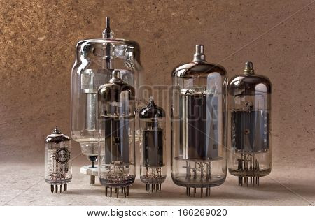electronic background with vacuum tubes on kraft paper