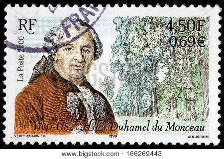 LUGA RUSSIA - SEPTEMBER 18 2015: A stamp printed by FRANCE shows image portrait of Henri-Louis Duhamel du Monceau - a French physician naval engineer and botanist circa 2000
