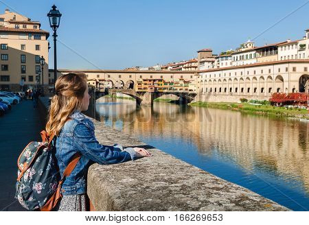 Young Girl Enjoying The View Of Ponte Vecchio In Florence, Tuscany, Italy.
