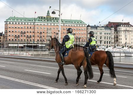 STOCKHOLM SWEDEN - OCTOBER 26:polition patrols the city on horsesSWEDEN - OCTOBER 26 2016. In Sweden the police often uses horses for movement.