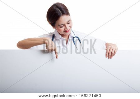 Young Asian Female Doctor Point And Look Down To Blank Sign.
