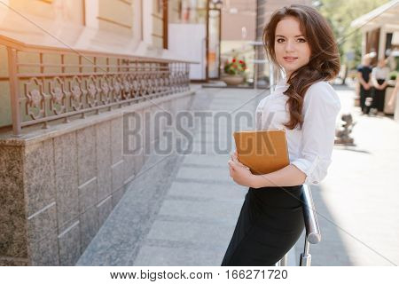 young beautiful business woman spends time alone with her gadgets and solve business issues