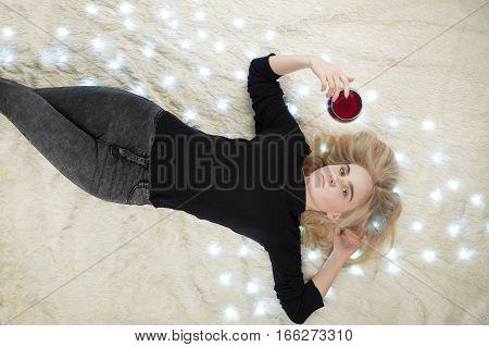 beautiful girl lying on fur with glowing lights