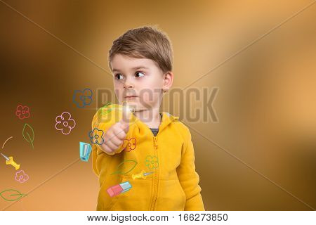 Portrait of beautiful little boy giving you thumbs up with flowers on background.
