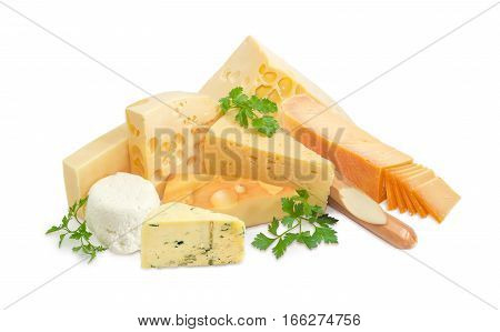 Several different pieces of hard cheese semi-hard cheese and soft cheese various types and twigs of parsley on a light background