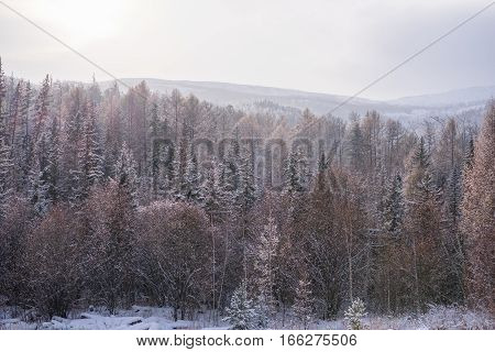 View of snow-covered mountains on a cold day