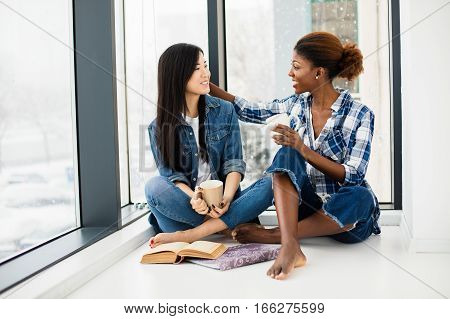 Concept Of Two Different Ethnicities, Asian And Afro American Girls Being Close Friends