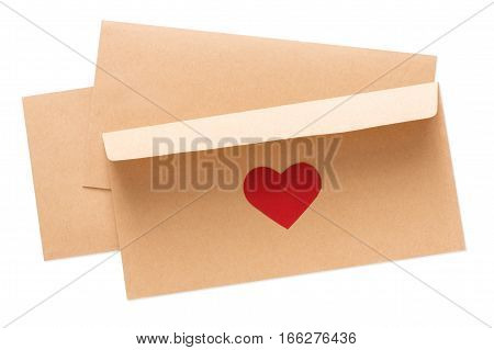 Valentine day letter. Envelope from craft paper with red heart on it, isolated on white background. Lover's holiday confession or proposal concept