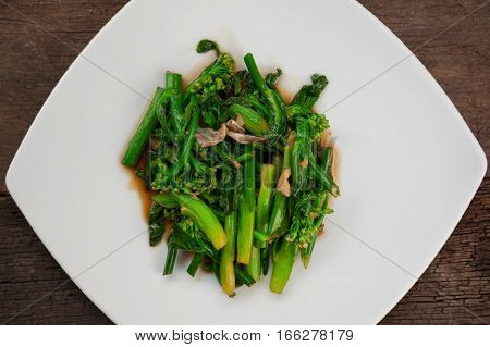 Stir-fried chines broccoli in oyster sauce white bowl
