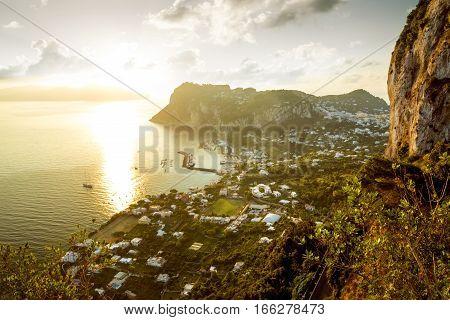 Panoramic view of Capri Island at sunrise Italy
