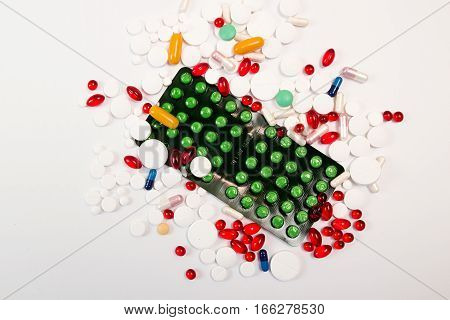 Heap Of Tablets And Pills On White Background.