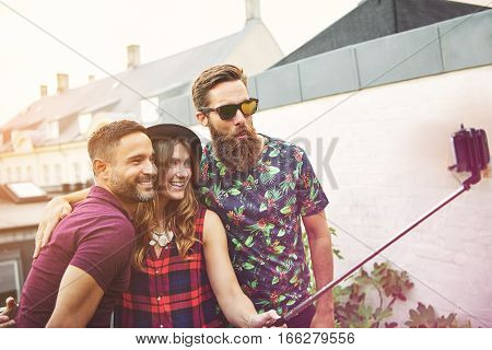Man With Beard And Sunglasses Takes Photo