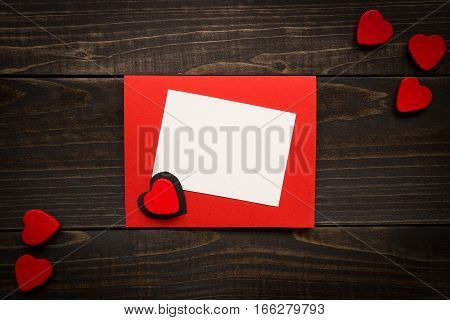 Valentine's Day Card On The Wooden Background. Gift Box, Red Hearts On The Wooden Desk.