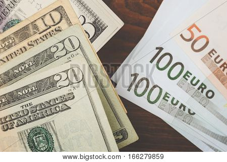 Background with money american dollar bills and euro banknotes. Top view.