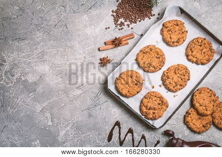 Homemade Chocolate Chip Cookies on metal oven-tray on gray background Ready to Eat