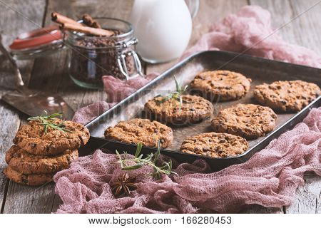 Homemade Chocolate Chip Cookies on metal oven-tray over wooden background Ready to Eat