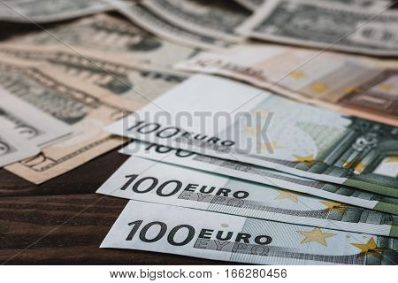 Background with money american dollar bills and euro banknotes on table. Money background
