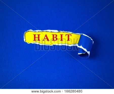 Torn blue Paper and space for habit text with a yellow paper background change habit concept