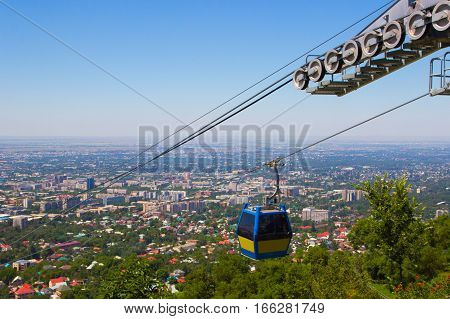 Almaty city view from Koktobe hill and cabin of cable car Kazakhstan 2016
