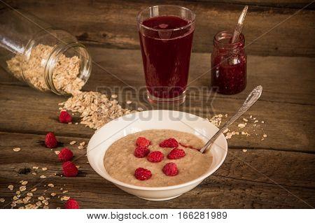 Healthy breakfast Oatmeal porridge with raspberries and beverage