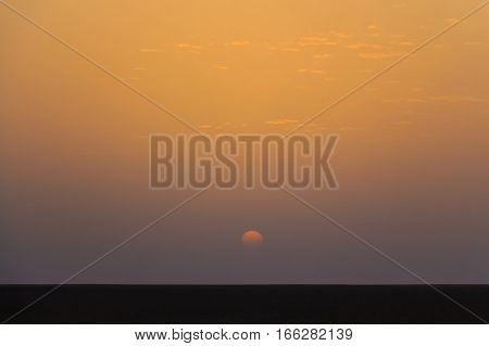 Image of typical desert landscape with sunset