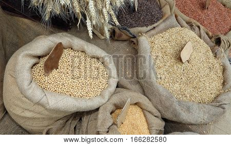 Bags Of Jute With Oat Seeds And Soybeans For Sale At The Market