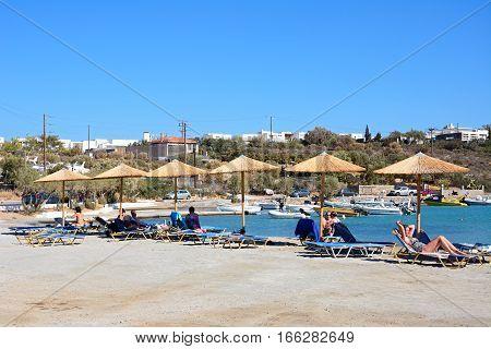 AGIOS NIKOLAOS, CRETE - SEPTEMBER 17, 2016 - Tourists relaxing on a small beach on the edge of town Agios Nikolaos Crete Greece Europe, September 17, 2016.