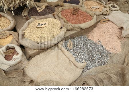 Many Sacks Of Grain With The Words In Italian For The Various Ty