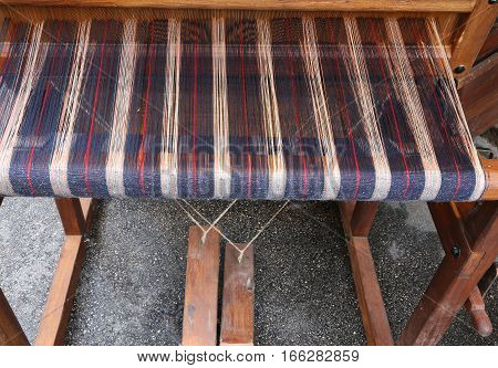 Working Antique Wooden Loom To Weave The Fabrics