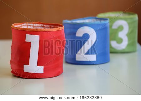 Three Jars For Toys With Numbers One Two Three And The Number On