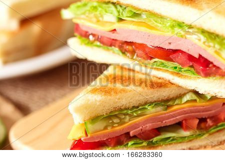 Sliced Grilled sandwiches bread with bacon ham and cheese with vegetable healthy breakfast