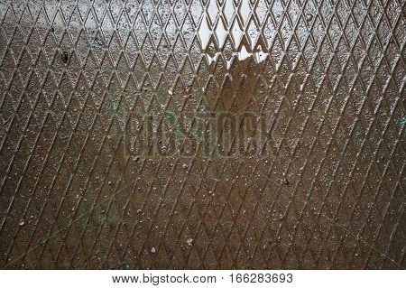 Texture of fluted rusty iron metal plate background