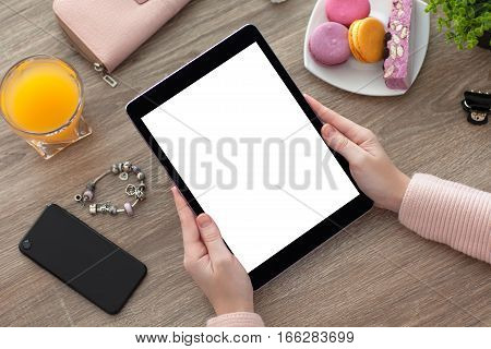 woman hands holding a tablet computer PC with isolated screen on the desk with phone