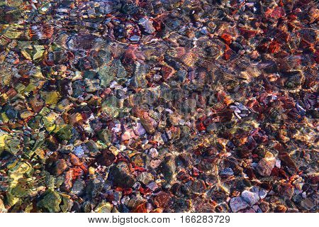 Stones sea bottom pattern, colored stone, clear water