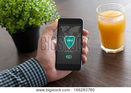 man holding phone with app vpn creation Internet protocols for protection private network