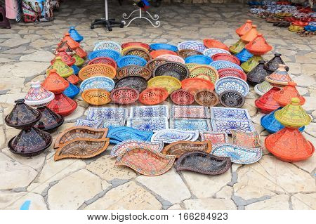 Decorative color dishes and pots at souvenir shop at oriental marketplace
