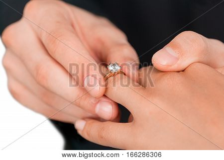 Groom Put a Ring on Finger of his Wife