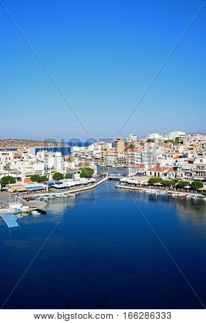 AGIOS NIKOLAOS, CRETE - SEPTEMBER 17, 2016 - Elevated view of the harbour and town Agios Nikolaos Crete Greece Europe, September 17, 2016.
