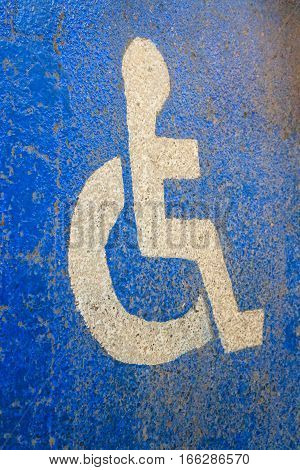 way for disabled, wheelchair sign on blue floor
