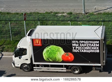 SAINT-PETERSBURG, RUSSIA - MAY 10, 2016: Car van McDonald's brought products to Pulkovo Airport. Inscription on back: