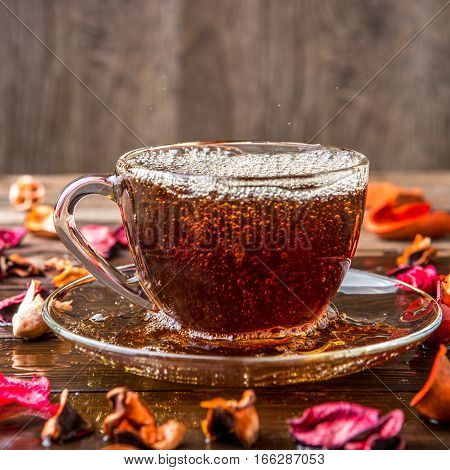 Black tea on brown table with rose hibiscus