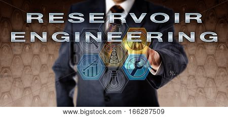 Corporate manager in blue business suit touching RESERVOIR ENGINEERING on an interactive virtual computer screen. Oil and gas industry technology concept for a special type of petroleum engineering.