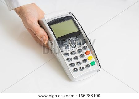 Hand Holds Payment Terminal On White Background.