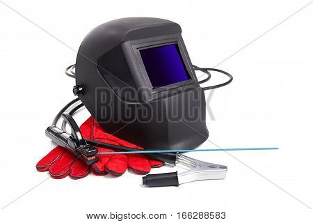 Welding equipment isolated on a white background, welding mask, leather gloves, high-voltage wires with clips, set of accessories for arc welding