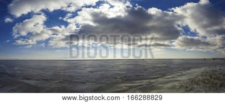 Beautiful frozen sea. Winter landscape in beach. Stock image.