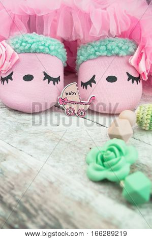 Little girlie baby shoes on a wood