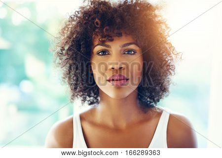 Thoughtful Young Black Woman With Sunlight Flare